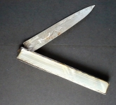 Knife with a silver blade and frame