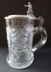 Tankard with a tin lid with a ruby middle