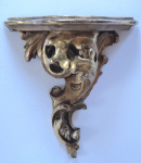 Small carved gilded console