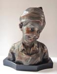 Bust of boy in cap