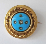Round brooch with blue enamel and diamant