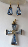 Gold cross and earrings with blue stones