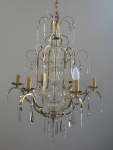 Polished brass chandelier with glass pendants