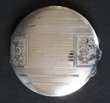 Silver powder box with engraved flowers