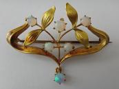 Gold Art Nouveau brooch with opals