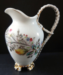 Jug with butterfly and braided handle