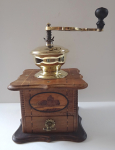 Wooden coffee grinder with inlaid cottage