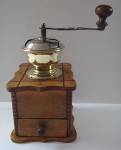 Wooden coffee grinder with inlaid lines
