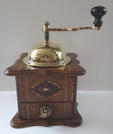 Coffee grinder with brass dome and medallion