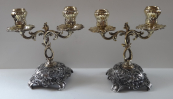 Pair candlesticks made of white and yellow metal