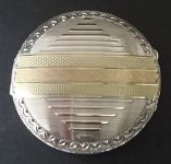 Round silver powder box with gold