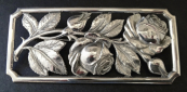 Silver brooch with embossed roses