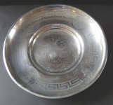 Silver round bowl with portraits