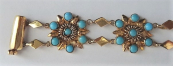 Segmented gold bracelet with turquoise