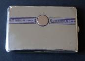 Silver cigarette case with a blue ornament