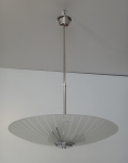 White metal chandelier with glass plate