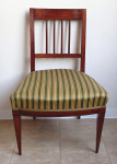 Chairs with sticks and striped upholstery