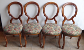 Four chairs with arched backrests