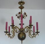Brass Dutch chandelier with purple candles