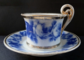 Cup with saucer, with blue roses