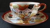 Porcelain cup with geisha