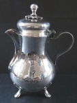 Small silver jug - four legs