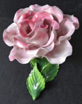 Porcelain rose with leaves