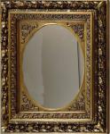 Oválné zrcadlo, ve zlatém rámu s vavřínovými listy