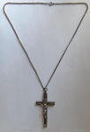A cross with a white metal chain