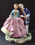 A big sculpture of a cavalier with a lady