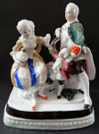 Aristocratic couple with child and grape - inkwell