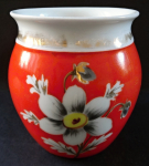 Red porcelain cup with flower