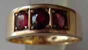 Golden ring with garnet and amethyst