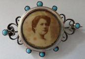 Silver brooch with photos and turquoise