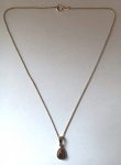 Gold chain with pendant and almandin