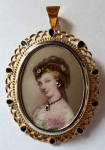 Golden brooch with portrait Sissi in ornate frame