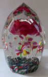 Paperweight with roses and colorful flowers