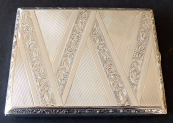 Silver case with engraved ribbon