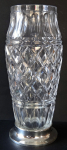 Glass cut vase with a silver base