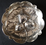 Silver small bowl with hazelnuts