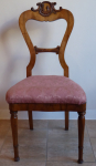 Chairs in walnut veneer, with carved rocaille work