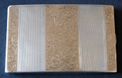 Silver cigarette case with gold engraved plaques