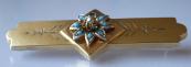 Stříbrná pozlacená brož s tyrkysy a říční perličkou