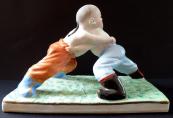 Dva asijští zápasníci s copánky