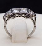 Platinový prsten, čtyři brilianty 0,65 ct