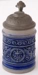 Keramický malý korbel s neorenesančním motivem
