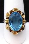 Zlacený stříbrný prsten s modrým kamenem