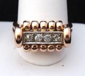 Zlatý prsten s vlnkami a brilianty cca 0,20 ct