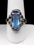 Oválná stříbrný prsten s modrým kamenem